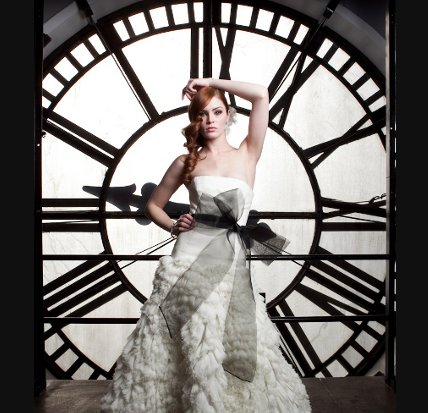 Bride in front of clock